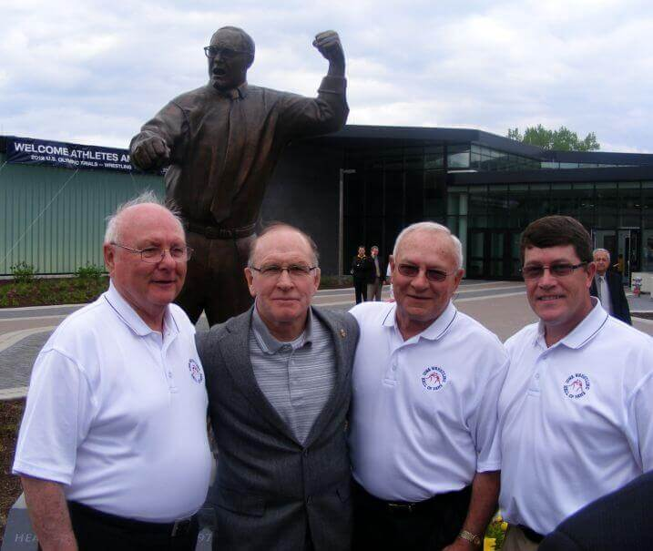 IWHOF Board Members Attend Unveiling of Statue in Honor of Dan Gable News Photo