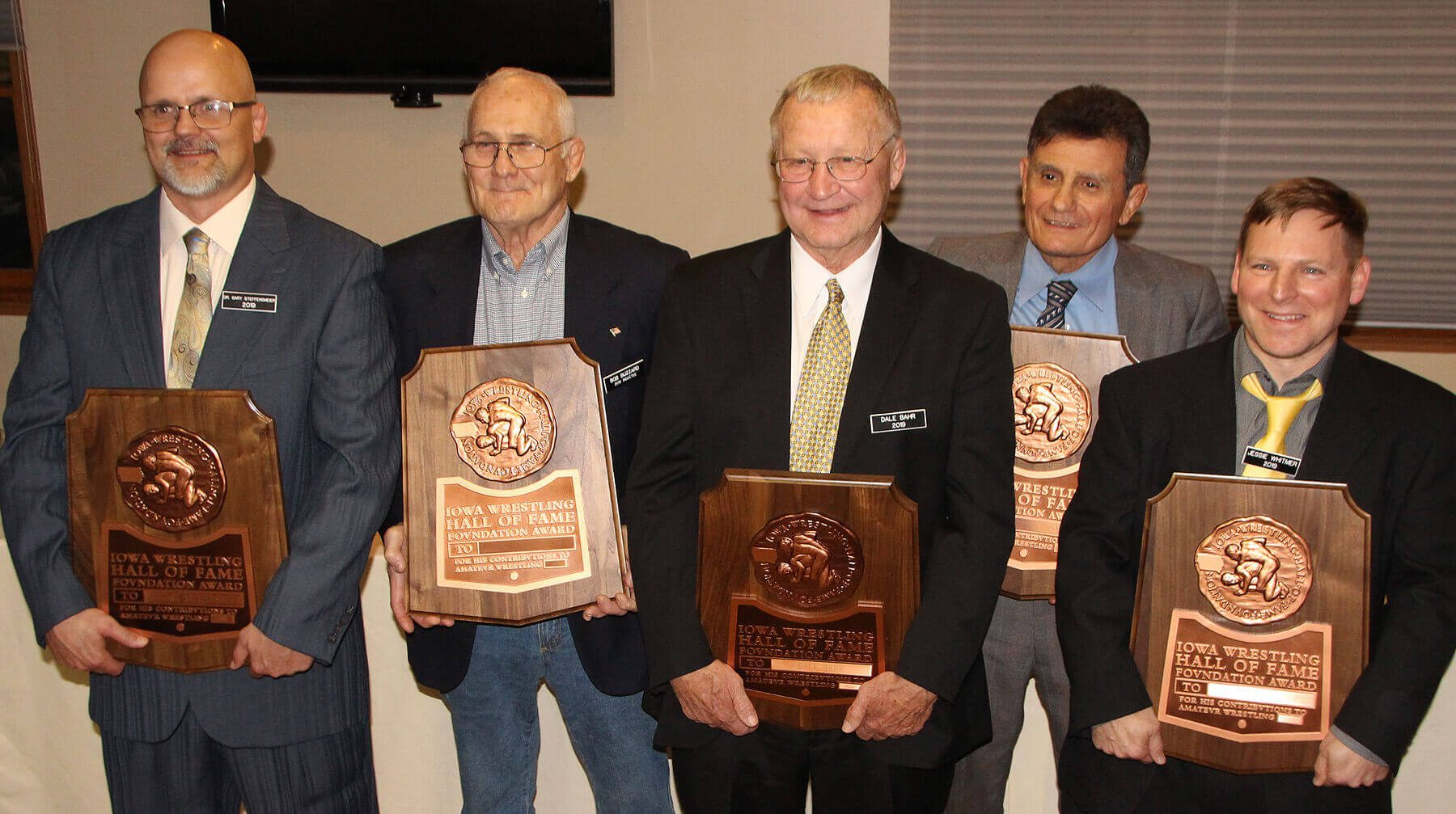 2019 Inductees Steffensmeier, Buzzard, Bahr, Corso, and Whitmer with plaques